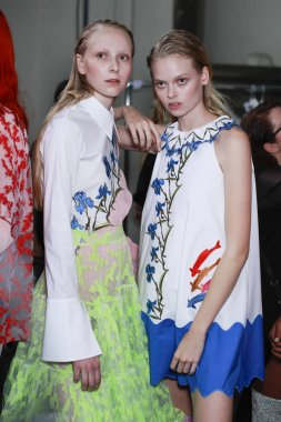 MILAN, ITALY - SEPTEMBER 21: Models are seen backstage ahead of the Vivetta show during Milan Fashion Week Spring/Summer 2018 on September 21, 2017 in Milan, Italy.