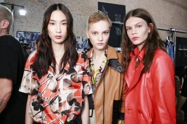 MILAN, ITALY - SEPTEMBER 24: Models are seen backstage ahead of the Trussardi show during Milan Fashion Week Spring/Summer 2018 on September 24, 2017 in Milan, Italy.