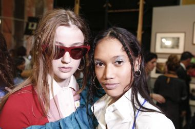 MILAN, ITALY - SEPTEMBER 24: Models are seen backstage ahead of the Stella Jean show during Milan Fashion Week Spring/Summer 2018 on September 24, 2017 in Milan, Italy.