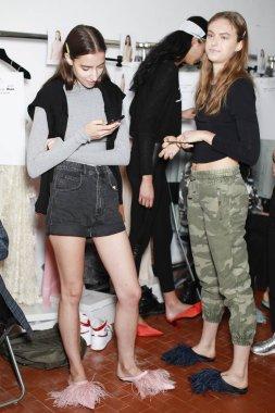MILAN, ITALY - SEPTEMBER 21: Models posing  backstage before Erika Cavallini show during Milan Womens Fashion Week on SEPTEMBER 21, 2017 in Milan.