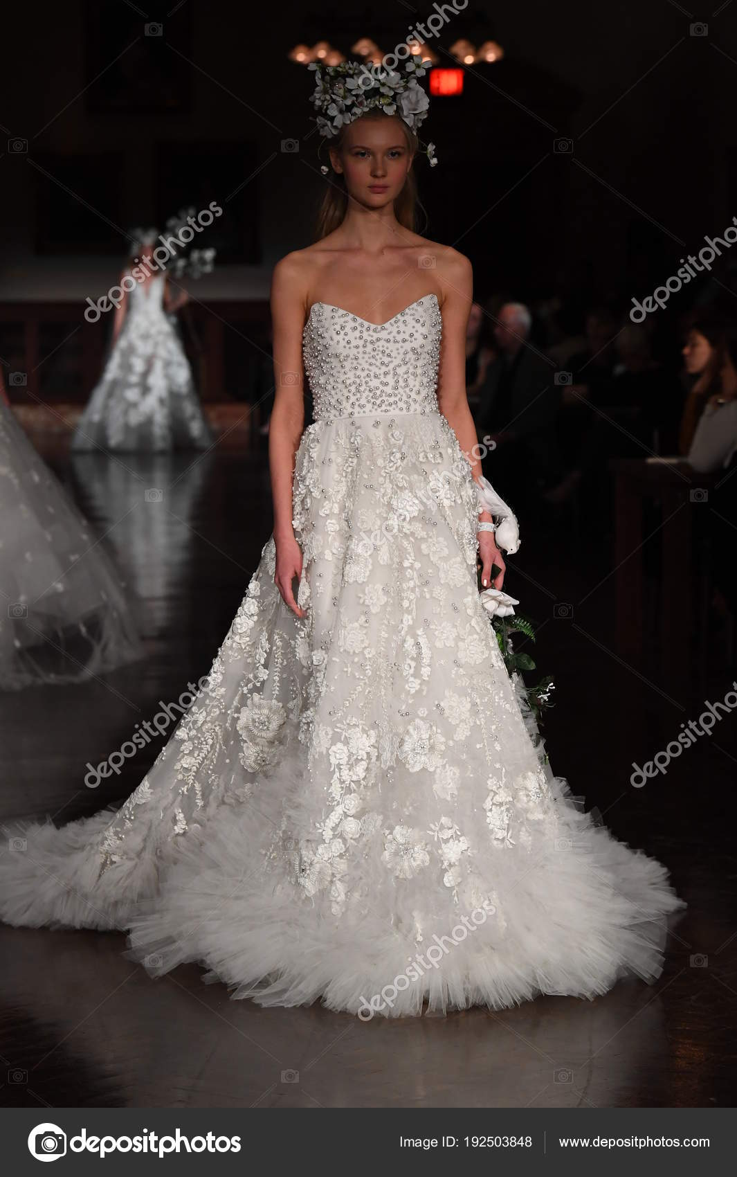 1cf70da79c32 NEW YORK, NY - APRIL 12: A model walks the runway wearing Reem Acra Spring 2019  Bridal Collection at the New York Public Library on April 12, ...