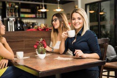Cute women relaxing at a cafe