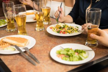 Closeup of people eating in a restaurant