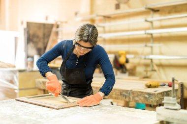 female carpenter working in woodshop