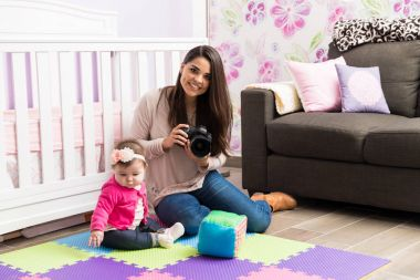 Cute female photographer with a baby
