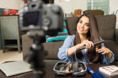 Hispanic woman recording video blog