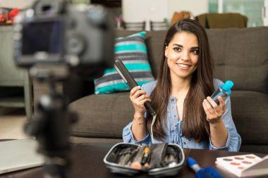 Woman sharing hair secrets on a vlog