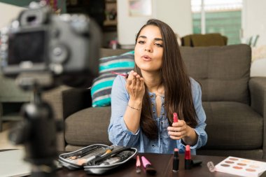 Beauty video blogger blowing a kiss