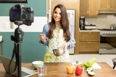 Food blogger recording a video