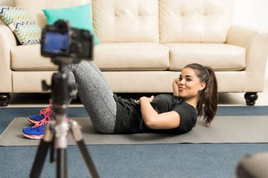 Fitness blogger and coach recording video