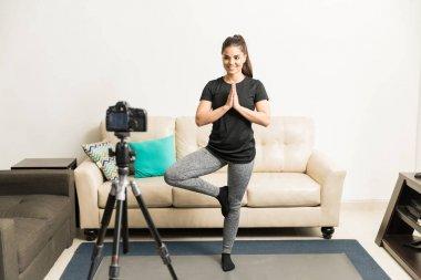 Yoga blogger recording a video