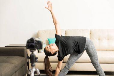 Fitness blogger doing some yoga