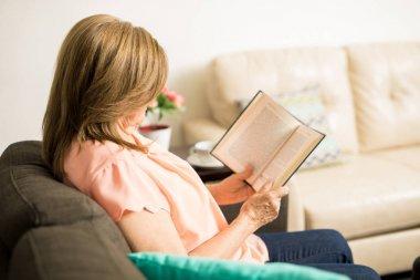 Elder woman enjoying her reading time