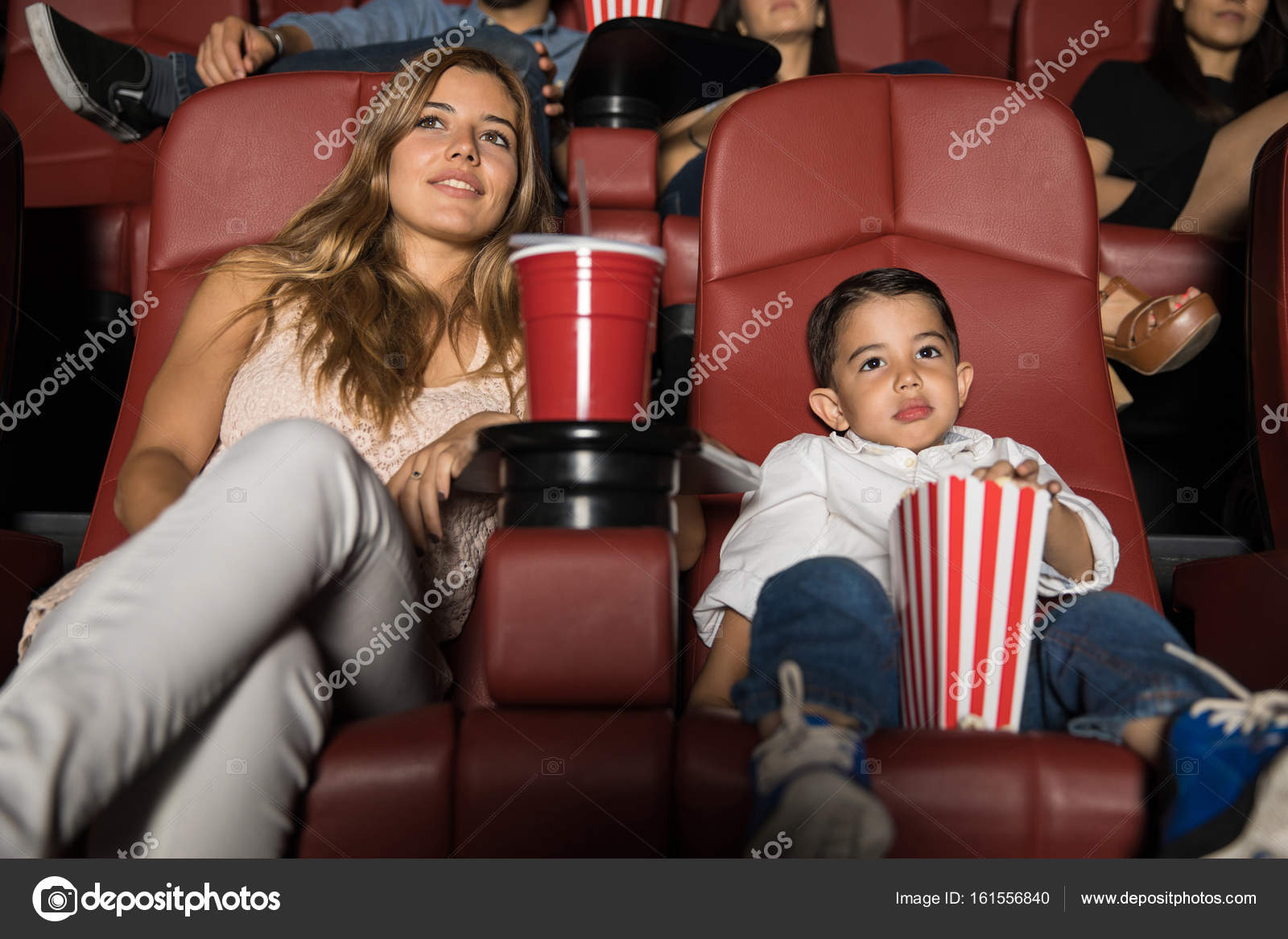 Little Boy And Mom In Cinema