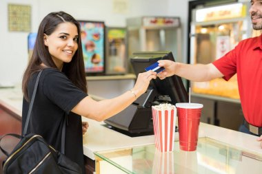 Woman buying snacks in movies