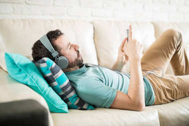man with headphones in living room