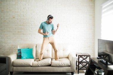 man with headphones in living room