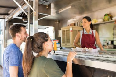 Customers making line in a food truck
