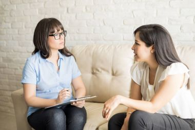 Psychologist talking to female patient