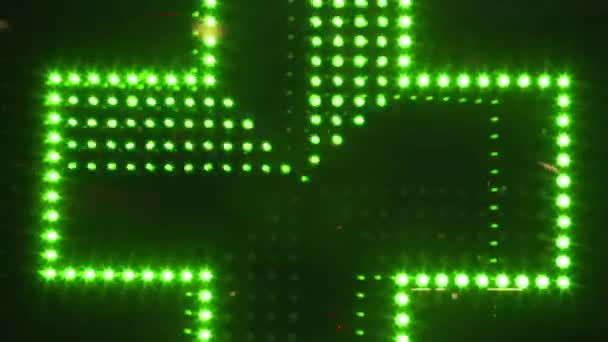 Handheld shot of a flashing LED pharmacy sign
