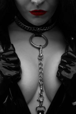 Strict mistress in black latex dress