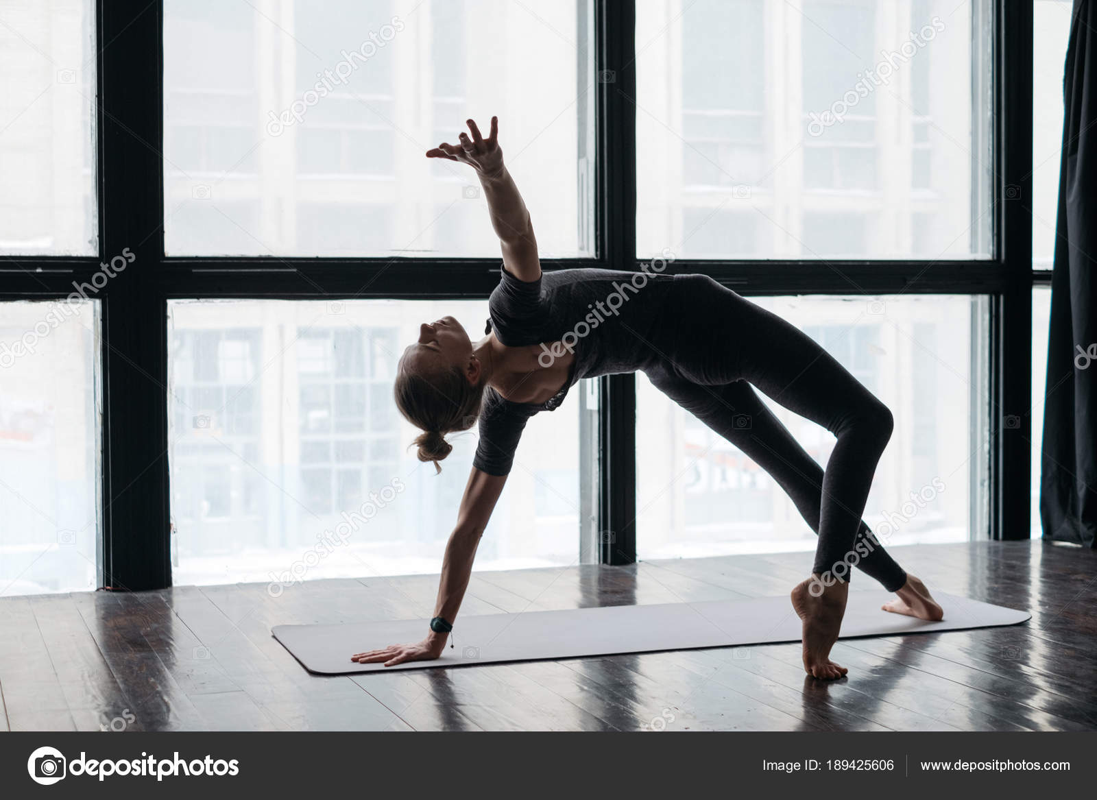 13f07d0892a7 Young Flexible Sporty Woman Practicing Yoga Windows Wooden Floor — Stock  Photo