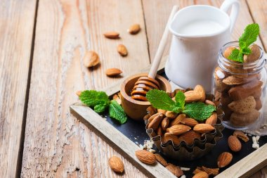 Almond milk with ingredients and honey for healthy breakfast