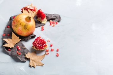 Harvest fall autumn concept. Ripe juicy pomegranate