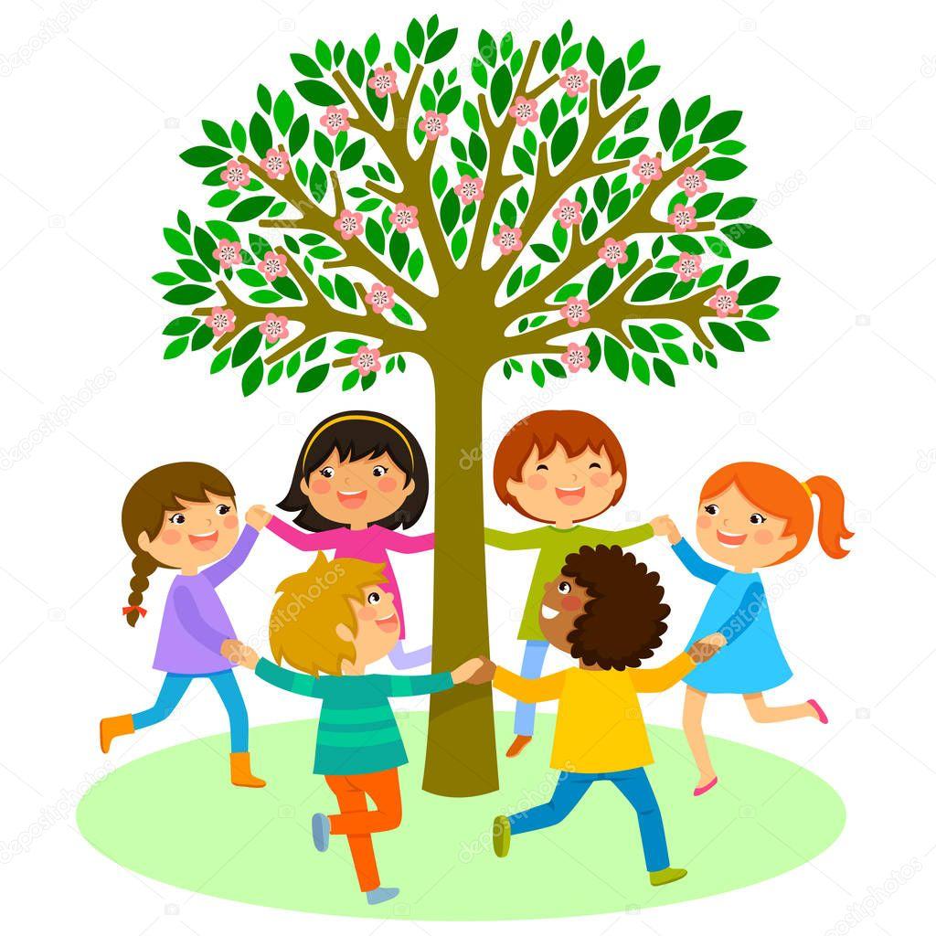 kids dance around a tree