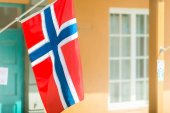 Flags on wall of building in Trondheim, Norway.