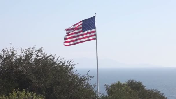 American and USA flag Union waving in front of blue sky