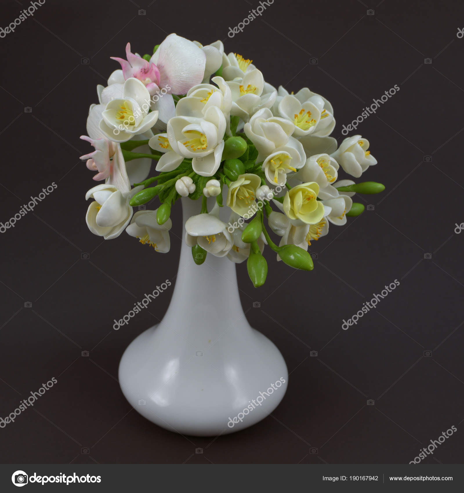 Hand made polymer clay flower bouquet in a white vase on a dark beautiful hand made flowers of polymer clay photo by olegvd izmirmasajfo