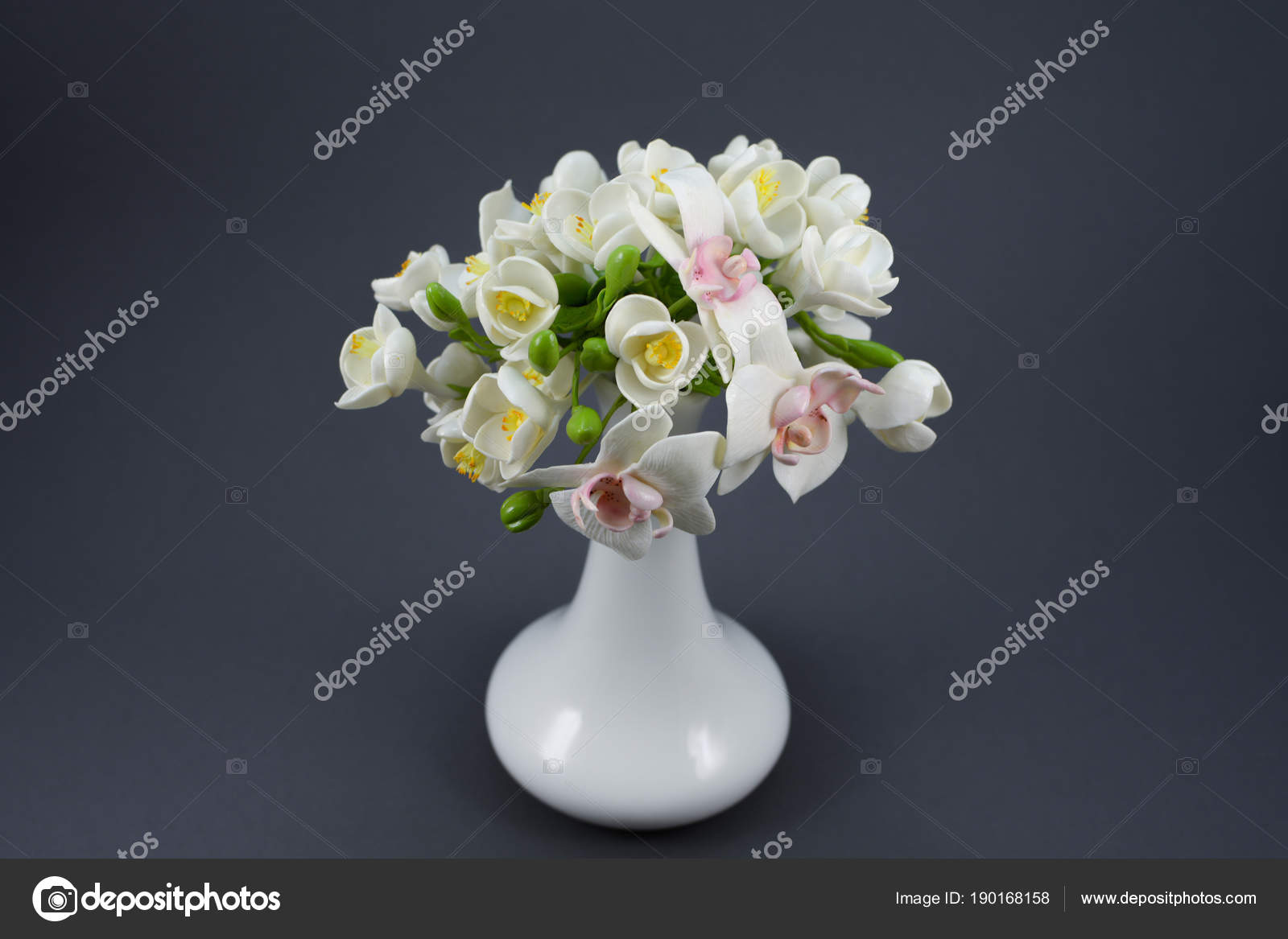 Polymer clay flower bouquet in a white vase on a gray background beautiful hand made flowers of polymer clay on a gray background photo by olegvd izmirmasajfo