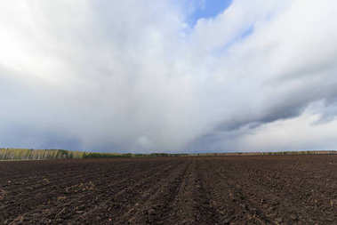 Clouds over arable land close-up