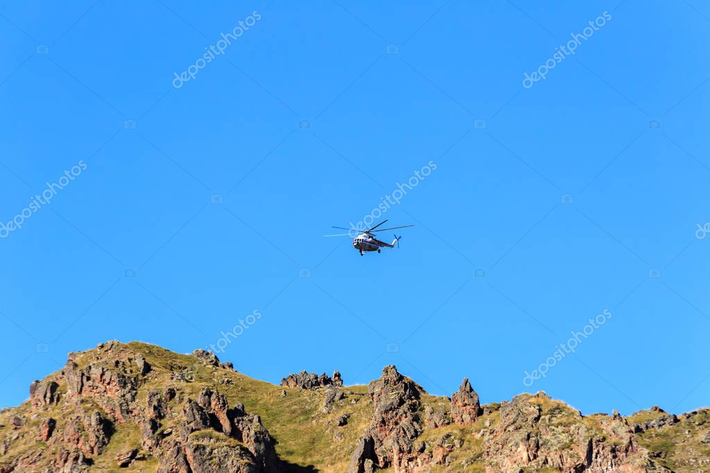 Helicopter over rocks