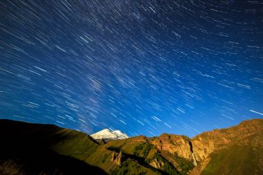 Stars draw lines and clouds. Night landscape. Russia. Mount Elbr