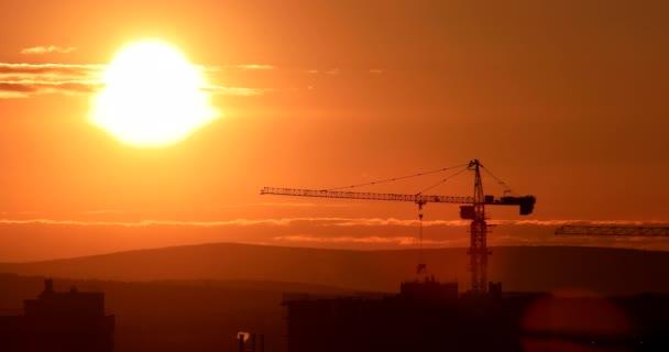 tower crane at construction site against sunset sky. Ekaterinburg, Russia. Video. UltraHD (4K)