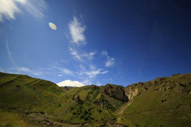 Moon over Mount Elbrus. Night landscape. Russia