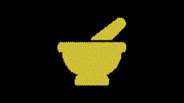 Symbol mortar pestle is knitted from a woolen thread. Knit like a sweater