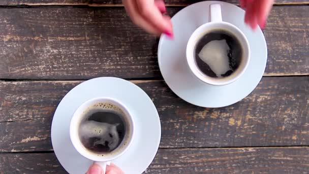 Cups with a coffee in the hands