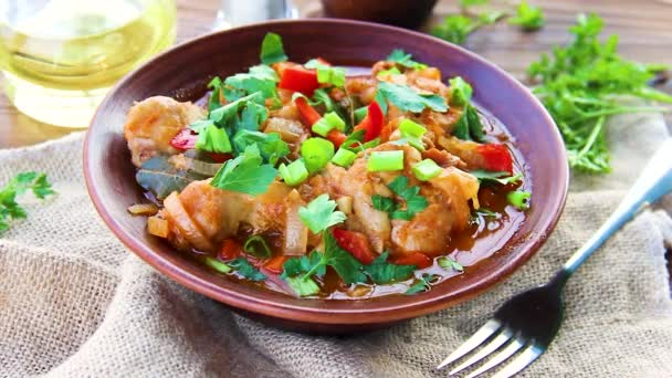 chicken stew with onion and vegetables in tomato sauce.