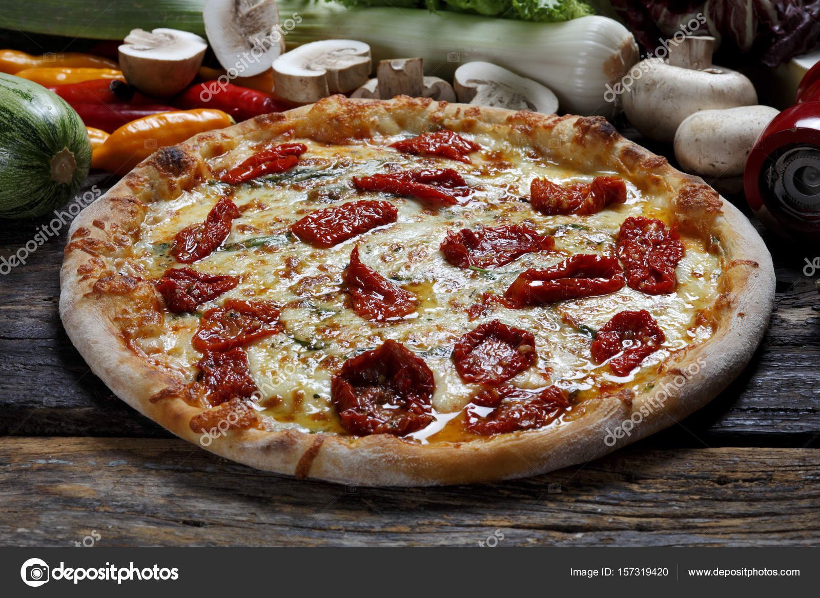 Pizza In De Oven.Delicious Pizza In The Wood Fired Oven Stock Photo