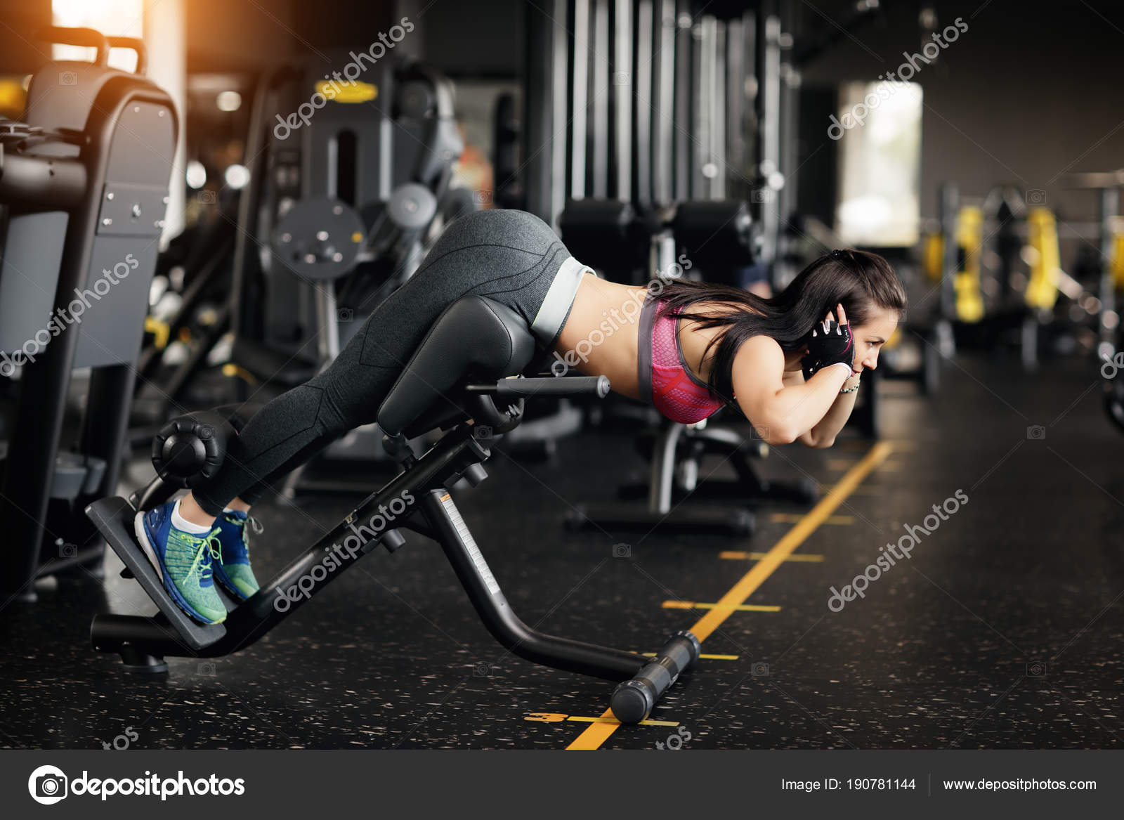 Amazing Athletic Young Woman Doing Hyperextension In The Gym Woman Ibusinesslaw Wood Chair Design Ideas Ibusinesslaworg