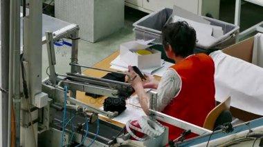 Female Worker in a Sock Factory