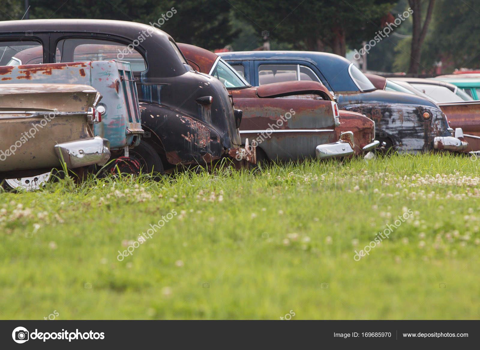 Rusted Antique Cars Sit In A Georgia Auto Junkyard — Stock Photo ...