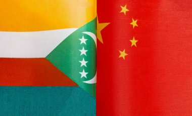 fragments of the national flags of the Union of Comoros And China in close-up