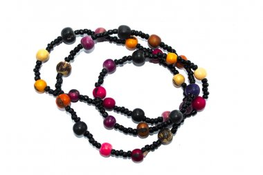 indigenous necklace black with yellow, orange, purple, pink and black seeds.