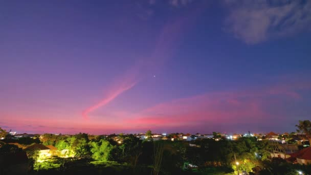 Balinese night in Canggu. Moving blue sky after sunset. Bali, Indonesia