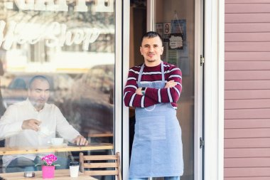 Small business owner reopening street coffee shop after lockdown quarantine