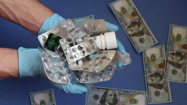 Paying for treatment. Empty medicine bottles and dollars. Empty bottles, syringes and blister packs in the doctors hands